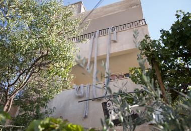 An exterior view of the making of the Entrelac - Raya Kassisieh & Nader Tehrani (NADAAA)
