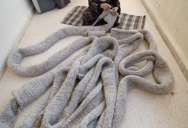 Local craftswoman works on the Entrelac - Raya Kassisieh & Nader Tehrani (NADAAA)